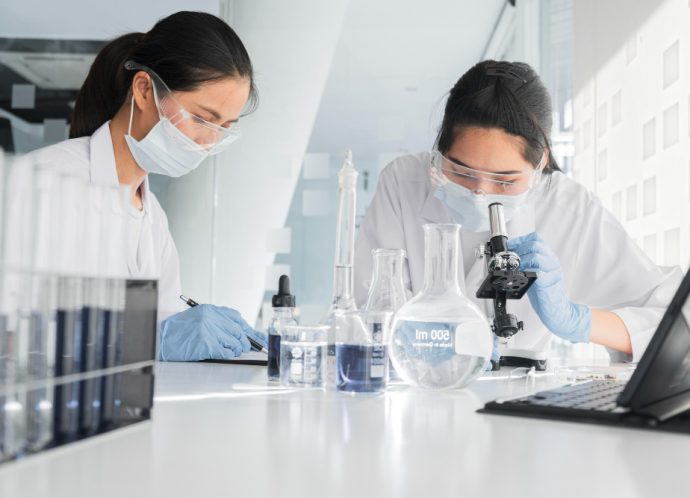 front-view-asian-women-working-together-chemical-project (1)